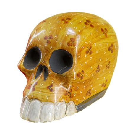 Typical Mexican skull painted isolated on white background. Dia de los muertos. Creative and minimal Day of the Dead or Halloween layout. Skull yellow 版權商用圖片