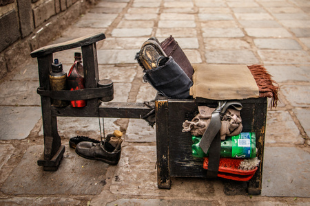 Shoes cleaning set on the street of Cuzco, Peru