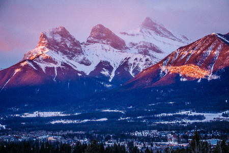 Three sisters mountain view at sunrise time in Canmore town, Canada