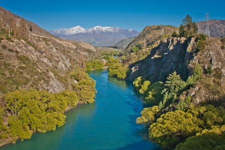 Shimmering blue water of Kawarau river near Queenstown, New Zealand