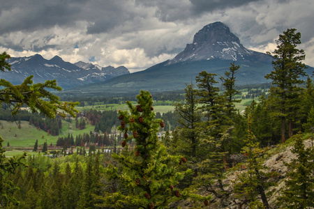 Majestic Crowsnest mountain in Southern Canada from Blairmore Rainbow falls viewpoint