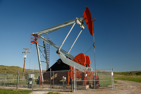 Pump jack on oil field in southern Alberta in Canada, oil industry