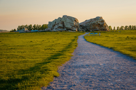 Point of interest near Okotoks, southern Alberta, Canada, big stone from ice age in the middle of flat meadow