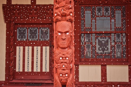 Outside wall of Maori church in Rotorua in New Zealand, Sightseeing of North Island of New Zealand, taditional carving, maori indigenous culture, tribal hand made art