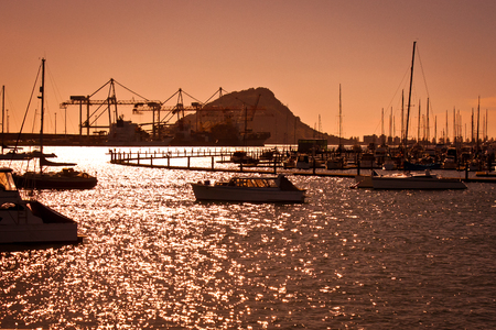 Sunset at Mt.Maunganui in New Zealand, Beauty of Bay of Plenty area, visit of Tauranga area, harbor of New Zealand, orange background of sunset light