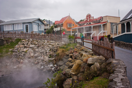 Rotorua maori village in New Zealand, hot spring pool as typical phenomenon of North Island of New Zealand, traditional maori village