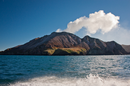 White Island in North Island of New Zealand, Aotearoa as maori name of country in Australasia, volcanic island with sulphur smoke, geologically young land, boat trip to island, natural wonder