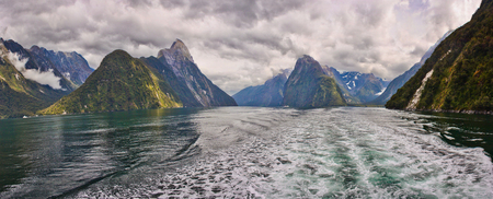 Boat tour on Milford Sound fjord in New Zealand, touristic places in New Zealand, New Zealands tourism, panoramatic view of Milford sound, on the water