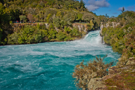 Beatiful blue water beneath of Huka Falls in Taupo in New Zealand, perfect water for rafting, adventure tourism of New Zealand, powerfull waterfall