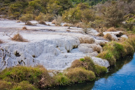 White travertin terraces in New Zealand, Waimangu geothermal park as part of Ring of fire in Australasia