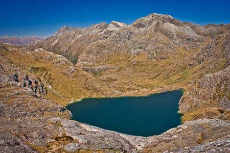 Harris lake from Conical hill on Routeburn track in New Zealand, South island of NZ, mountain adventure, great walks, trekking and camping