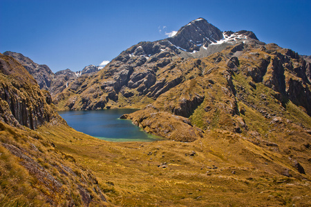 Harris Lake from the valley of Routeburn track in New Zealand, Lonely planet guide, natural beauty of New Zealand, South island of NZ, mountain adventure, great walks, trekking and camping