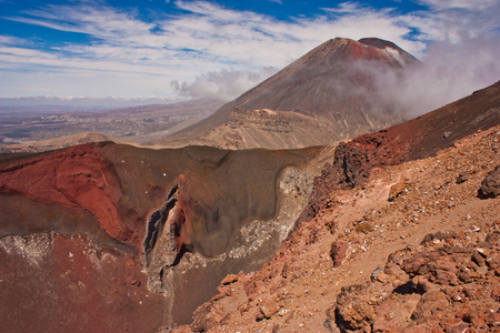 Red crater in Tongariro Crossing track with Mt. Ngaruhoe in background, New Zealand, New Zealands best great walk according Lonely Planet guide book, natural volcanic beauty, interesting geological destination, touristic place to see Reklamní fotografie