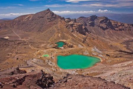 Emerald lake in rocky landscape of Tongariro NP, New Zealand, famous touristic destination of NZ, unique volcanic landscape of one of the most beatiful national park of New Zealand, amazing travel experience Reklamní fotografie - 116356412