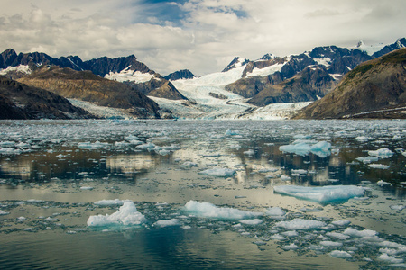 Columbia Glacier with frozen floes in Prince William sound, Alaska, boat trip to explore marine beauty of Alaskan coastline, touristic destination number one