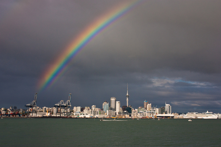 Rainbow above Auckland city in New Zealand, vacation in Oceania, zelandia adventure, modern city scape Reklamní fotografie