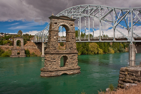 Historical suspension bridge in town of Alexandra in New Zealand, cultural sight, bridge crossing river in Alexandra