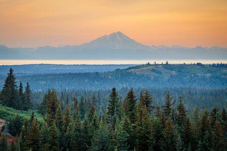 Mt. Redoubt volcano on sunset sky background, Alaska, Alaskan dream road trip, one life experience trip, beautifil memories of alaskan wilderness, wonderful landscape of far north, dreamy traveling Reklamní fotografie