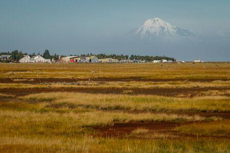 View of Mt. Redoubt volcano from town of Kenai, Alaska, foggy mountain view on blue horizon in Kenai Peninsula Reklamní fotografie