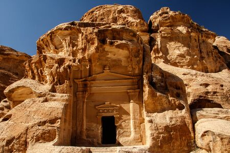Ancient nabataean house in city of Petra near Wadi Musa in Jordan, sandstone house, arabic culture