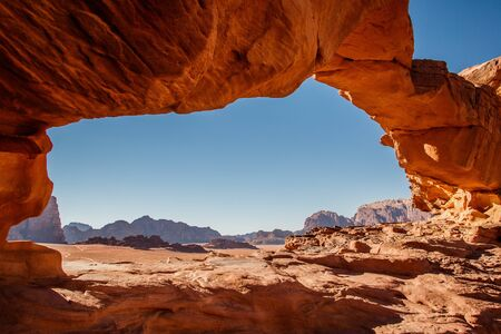 Framed view of Wadi Rum desert from Little Bridge rock formation in Jordan, popular touristic attraction, one of the most famous bridges in Jordan Banco de Imagens