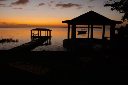Before sunrise on the bank of Bacalar lagoon in Mexico, lake of seven shades of blue