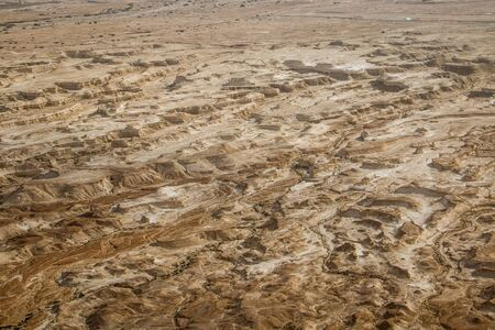 Interesting landscape of desert below Masada fortress on the bank of Dead Sea in Israel, dry canyon land