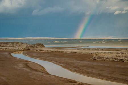 Rainbow after tropical storm above Dead Sea in Israel, worlds famous place for potash production Banco de Imagens