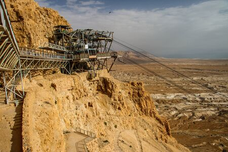 Famous touristic attraction of Masada fortress in Israel, cablecar station in israeli desert Reklamní fotografie
