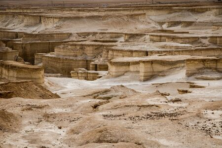 Interesting landscape between Dead sea and Masada fortress in Israel, by erosion created sandy canyons in dry israeli land