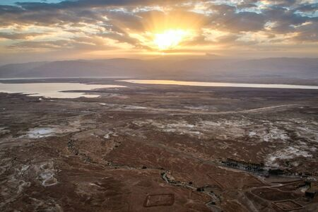 Sunrise above Israeli Dead Sea from national monument of Masada, dry landscape with very salted Dead sea of Israeli country