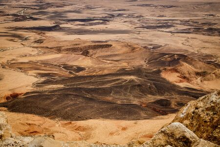 Deatail of unique colorful palette of Israeli Negev desert near Mitzpe Ramon, huge crater of the famous desert in Israel