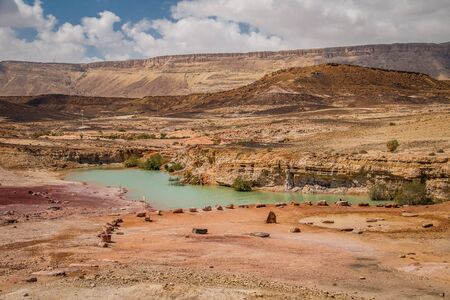 Green lake in Mitzpe Ramon crater in Israeli Negev desert, unique place in the middle of Israel, must see place on your trip into Israel, vacation in middle east countries Banco de Imagens