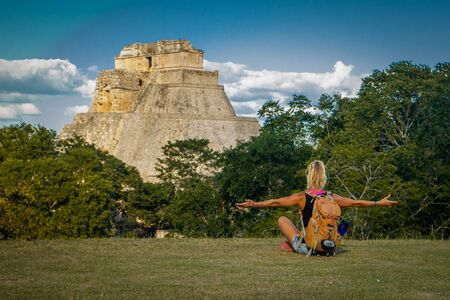 Freedom of backpacking lifestyle in Uxmal ruins in Mexico, european girl visiting mexico, travel lifestyle