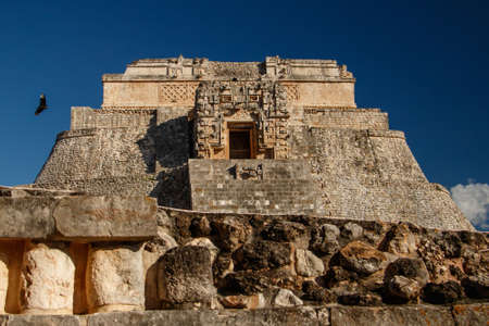 Main pyramid with flying condor in Uxmal site in Mexican Yucatan