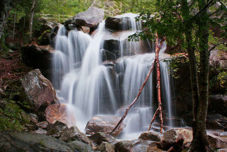 Watefall in early autumn in New Hampshire state, US, traveling in America