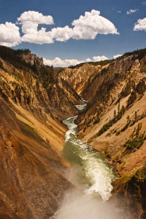 Yellowstone river in beautiful yellow canyon in unique national park, US, traveling Wyoming