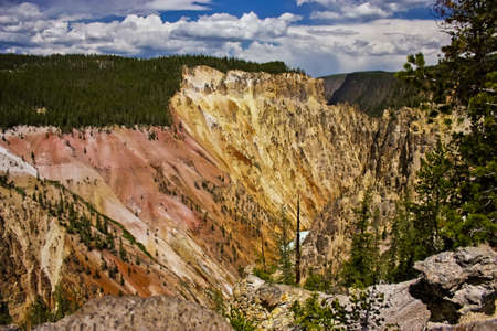 Colorful walls of Yellowstone river canyon in first national park on the world, US road trip, traveling in America