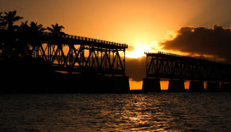 Old bridge on Key West in Florida during sunset time, US road trip 免版税图像