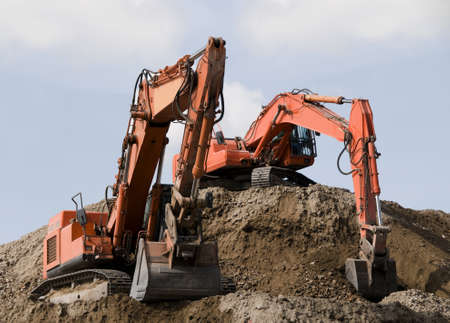 earth moving: Excavators during earth moving works at construction site Stock Photo