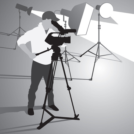 filming: Video camera operator working with his professional equipment isolated on white background.
