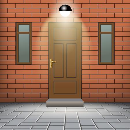 front door: Front door of a red brick wall with windows.
