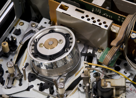 vcr: The inside of a old video recorder. Magnetic reading and recording head Stock Photo