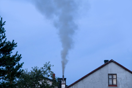 improper: Ecology problems. Chimney emitting air pollution due to improper burn of solid fuels