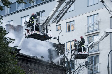 WARSAW, POLAND - AUGUST 30, 2015: Firefighters in action with water to put out the fire in Warsaw, Poland