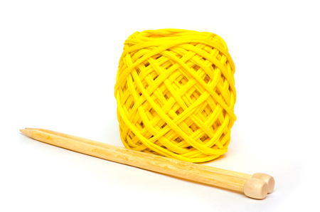 skein: skein of thick knitting yarn and wooden needles Stock Photo