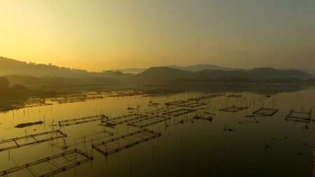 Fish pond in reservoir in the morning with aerial view