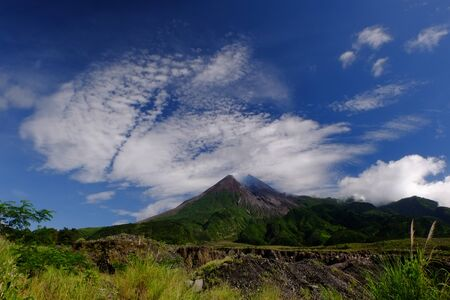 a volcano and savana in bright day Stock Photo - 124699858