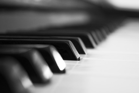 Piano keyboards black and white in macro