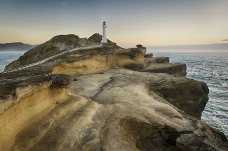 Sunrise at the Castlepoint lighthouse, Wairarapa, New Zealand. Banco de Imagens